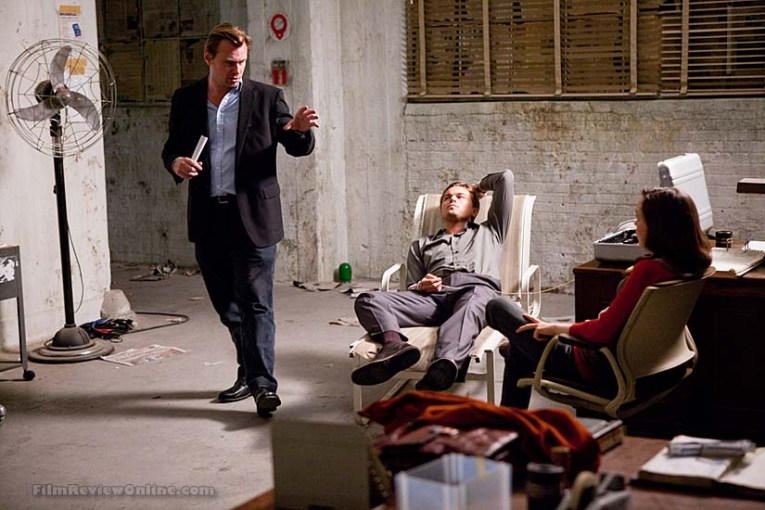 (L-r) Director CHRISTOPHER NOLAN with LEONARDO DiCAPRIO and ELLEN PAGE on the set of Warner Bros. PicturesÕ and Legendary PicturesÕ sci-fi action film ÒINCEPTION,Ó a Warner Bros. Pictures release.